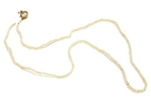 Lot 75-A single row graduated seed pearl necklace