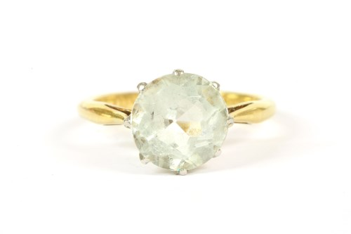 Lot 41-A gold single stone round cut aquamarine ring