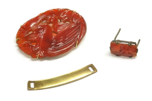 Lot 23-An Asian carved and pierced Cornelian plaque