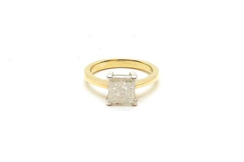 Lot 39-An 18ct gold single stone modified princess cut diamond ring