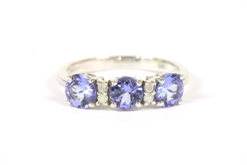 Lot 35-A 9ct white gold three stone tanzanite ring with pairs of diamonds between