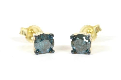 Lot 57-A pair of gold single stone treated blue diamond studs
