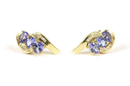 Lot 33-A pair of 9ct gold three stone tanzanite and diamond crossover stud earrings