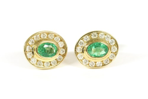 Lot 42-A pair of 9ct gold channel set oval emerald and diamond cluster studs
