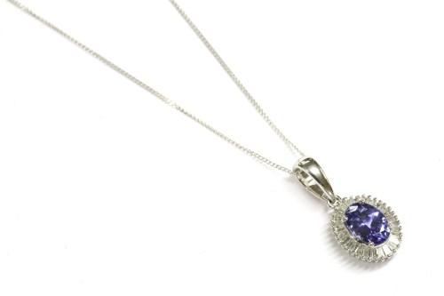 Lot 38-A 9ct white gold tanzanite and diamond cluster pendant