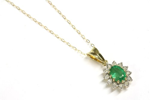 Lot 37-A 9ct gold oval cut emerald and illusion set diamond cluster pendant