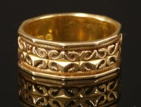 Lot 32-An 18ct gold Victorian chased band ring