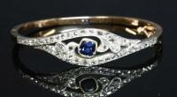 Lot 44-A Victorian sapphire and diamond crossover bangle