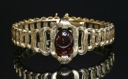 Lot 23-A French gold garnet set bracelet