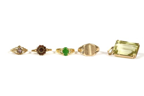 Lot 6-A gold single stone emerald cut citrine pendant