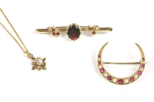 Lot 12-A gold split pearl and ruby open crescent brooch