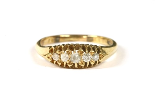 Lot 7-An Edwardian gold five stone boat shaped graduated ring