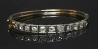 Lot 43-A cased late Victorian diamond set bangle