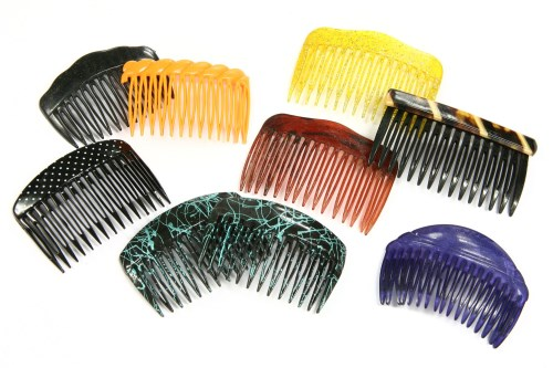 Lot 20-A box of costume jewellery and hair combs