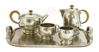 Lot 83-A Tudric pewter four-piece tea set