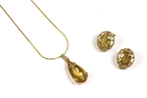 Lot 44-A gold single stone pear shaped citrine pendant