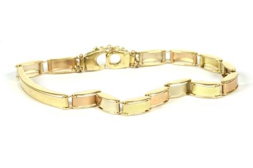 Lot 39-An Italian three colour gold identity bracelet