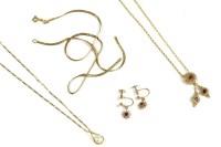 Lot 40-A gold ruby circular pendant