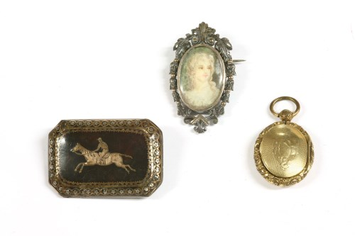 Lot 12-A tortoiseshell pique work brooch set with a racehorse and jockey