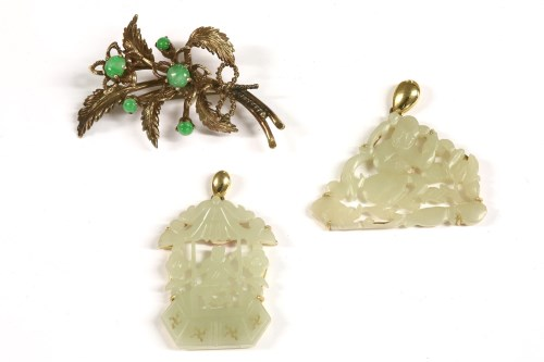 Lot 20-Two jade carved pendants