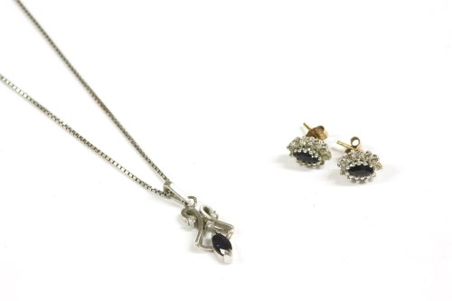 Lot 15-A pair of gold diamond and sapphire cluster earrings