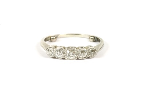 Lot 13-A white gold five stone graduated old Swiss cut diamond ring