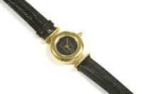 Lot 63-A ladies gold plated Fendi quartz strap watch