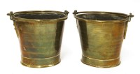 Lot 502-A pair of brass pail measures