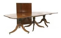 Lot 523-A George III mahogany three-pillar dining table