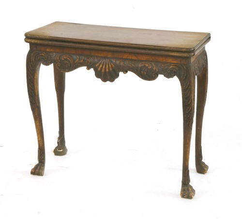 Lot 511 - An Irish mahogany fold-over card table