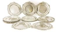 179 - A set of twelve William IV silver dinner plates