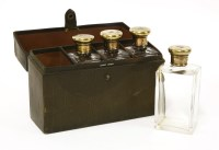 Lot 27-A set of four glass cologne bottles