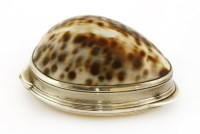 Lot 10-A George III Irish silver-mounted cowrie shell snuff box