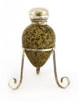 Lot 19-A late Victorian silver-mounted and simulated egg scent bottle