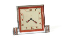 Lot 68-A cased Art Deco chrome and red enamel Smith's mechanical eight day Boudoir clock