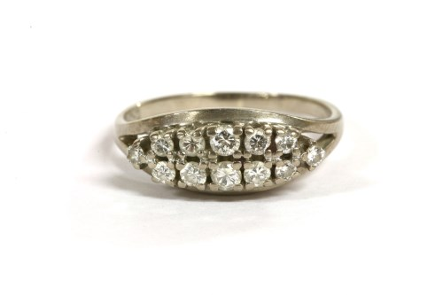 Lot 33-A white gold two row diamond boat shaped ring