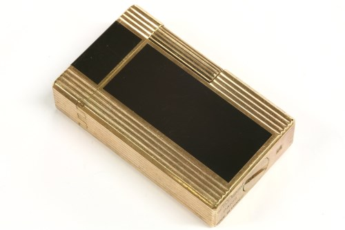 Lot 39-An S T Dupont gold plated lighter