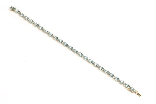Lot 16-A gold topaz and diamond line bracelet