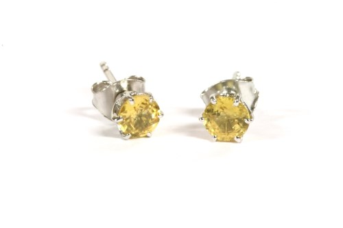 Lot 23-A pair of white gold single stone yellow sapphire earrings