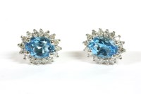 Lot 29-A pair of white gold topaz cluster earrings
