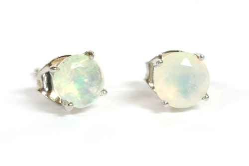 Lot 9-A pair of white gold single stone opal stud earrings