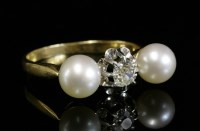 Lot 4-A three stone diamond and cultured pearl ring