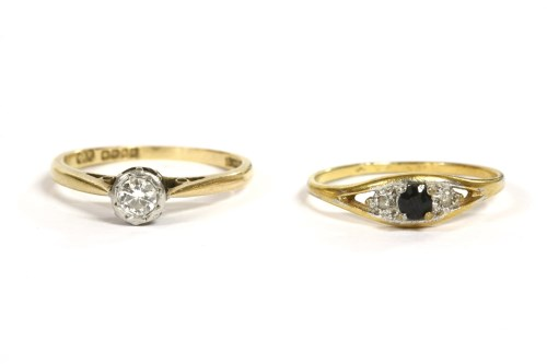 Lot 43-An 18ct gold single stone diamond ring
