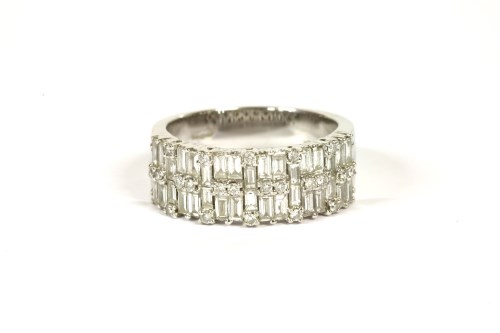 Lot 1-An 18ct white gold two row diamond band ring