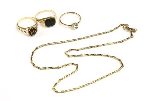 Lot 27-A gentlemen's 9ct gold onyx plaque signet ring