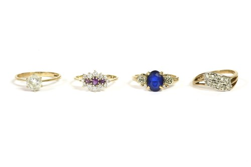 Lot 21-A gold single stone blue synthetic ring