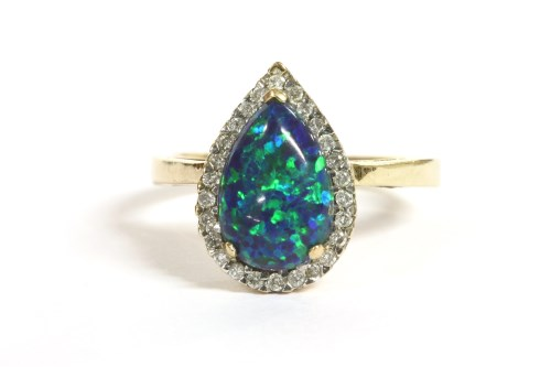 Lot 64 - A gold pear shaped synthetic opal and diamond cluster ring