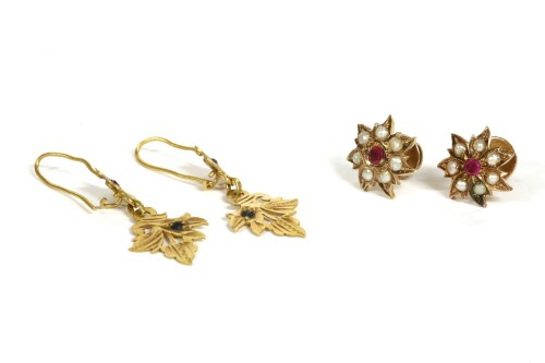 Lot 28-A pair of Indian gold synthetic ruby and split pearl floral cluster earrings