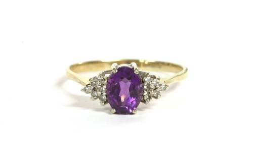 Lot 44-A 9ct gold oval cut amethyst and diamond cluster ring