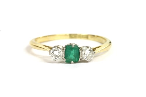 Lot 36-A gold emerald and diamond three stone ring